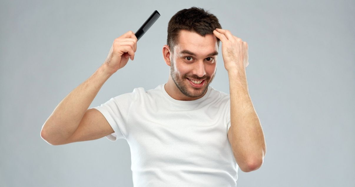 young_man_combing_hair