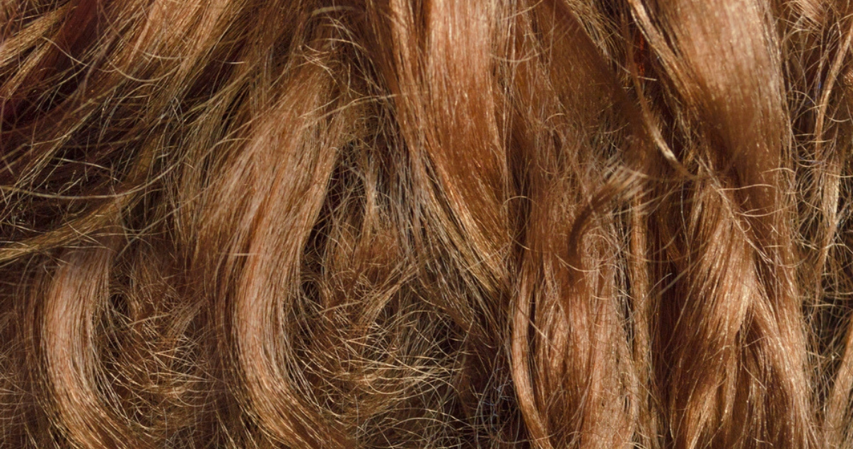 Closeup of dry brunette hair with split ends that needs homemade deep conditioner