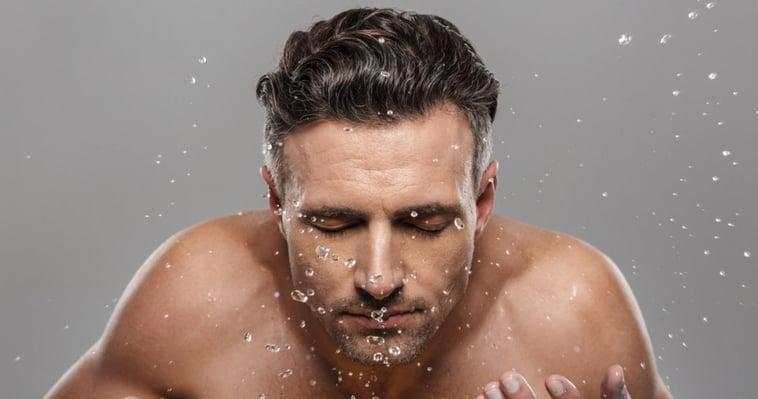 man slashing water before hair care