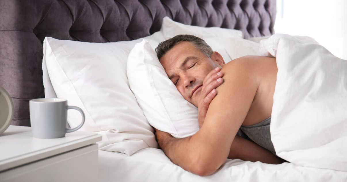 middle aged man sleeping comfortably in his hairpiece