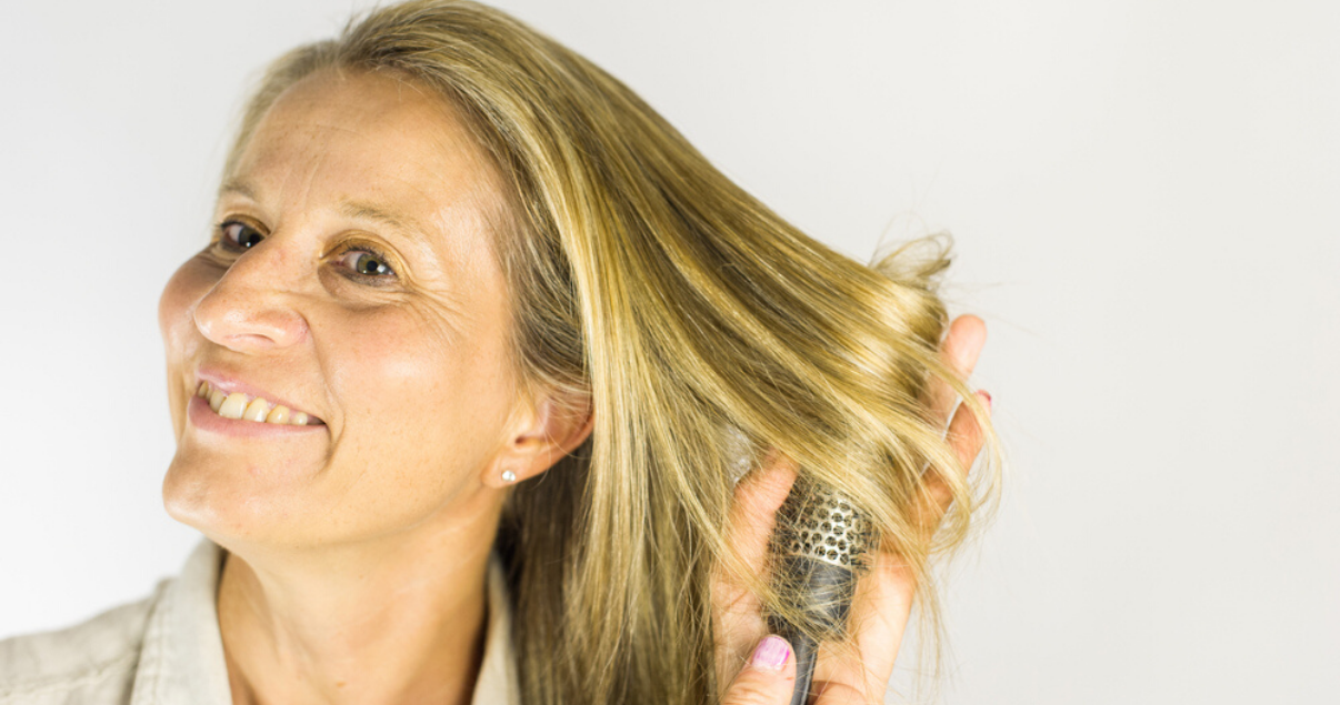 mature woman maintaining hair system to avoid tangles