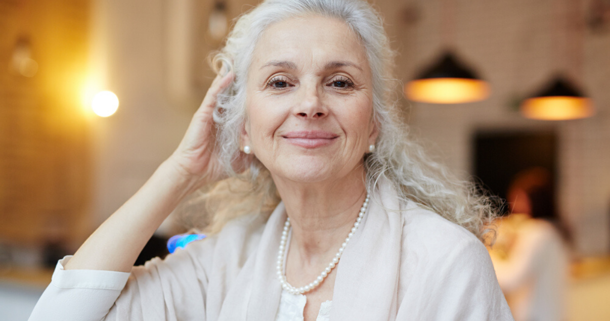 mature woman enjoying her new hair system style