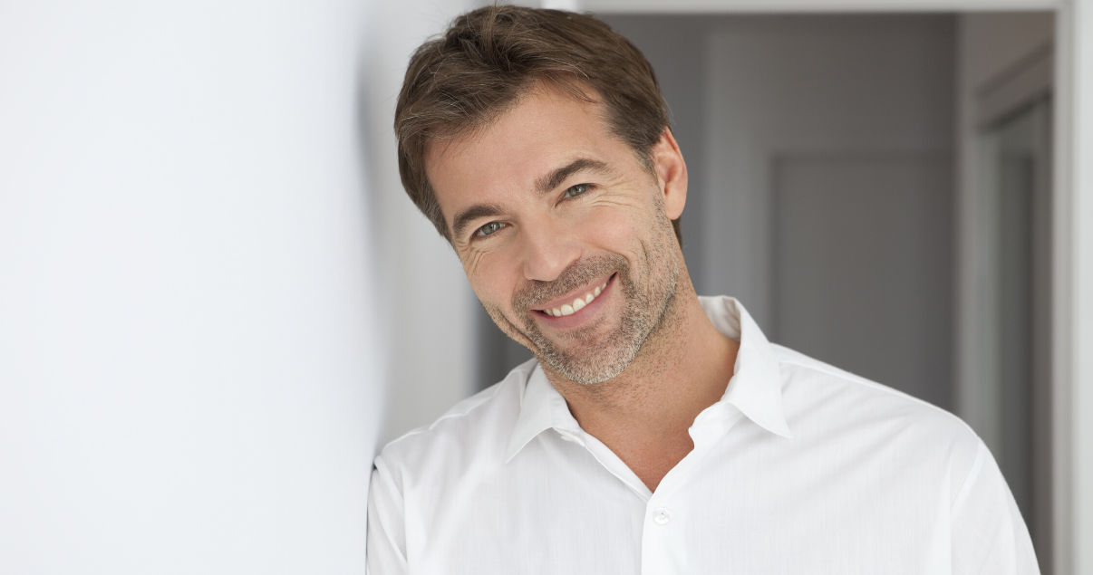 mature man brunette happy with hair system lifespan