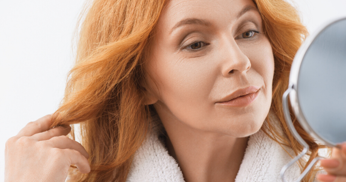 mature woman red hair happy with her longhair system lifespan