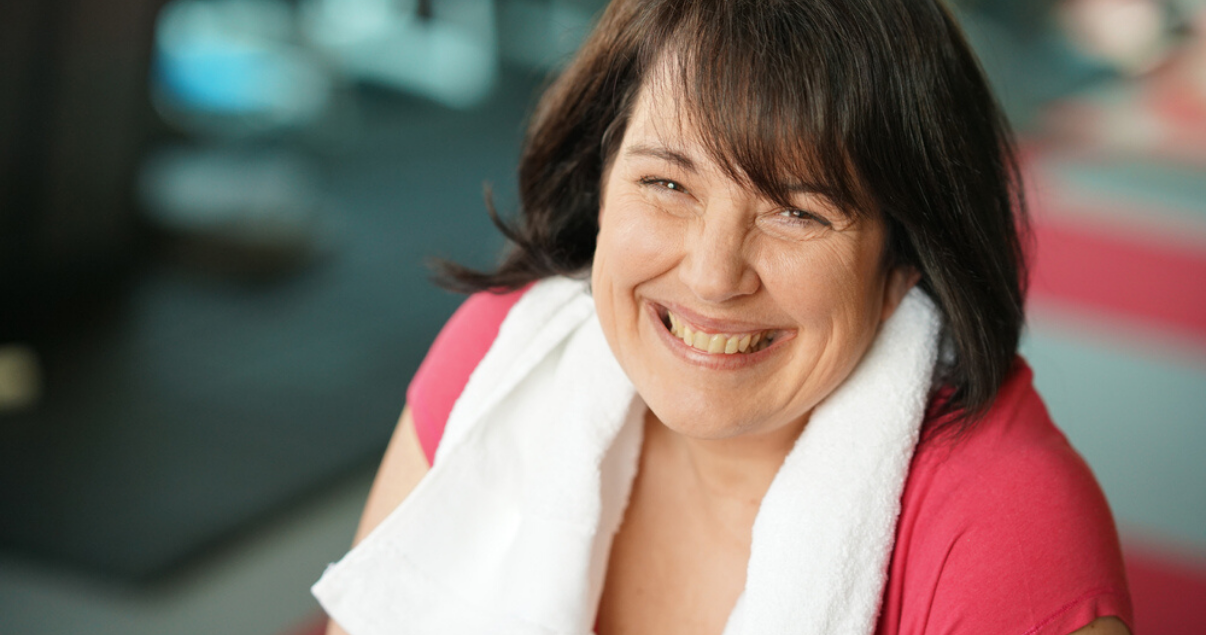 middle aged woman wondering how exercise affects hair system maintenance