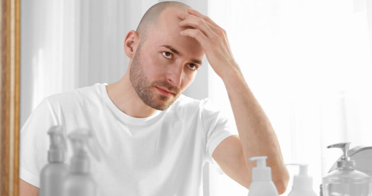 mature man following scalp maintenance advice by massaging scalp
