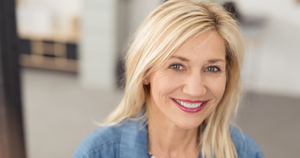 Middle aged woman happy with her soft hair system after using leave in conditioner