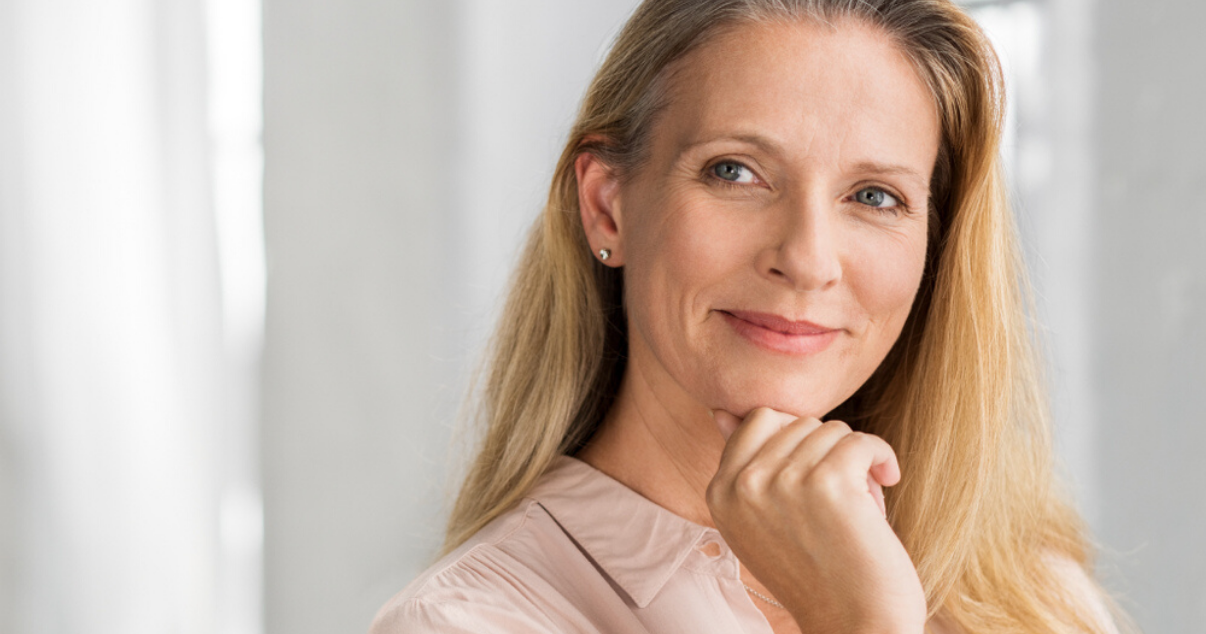 Middle aged woman wearing best stock hairpiece for women with easy hairpiece maintenance