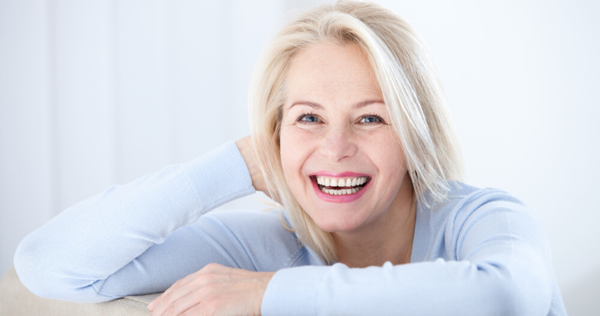 Middle aged woman wearing best stock hairpiece