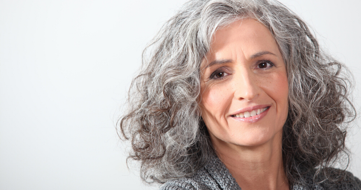 Senior woman wearing best hairpiece hair replacement system