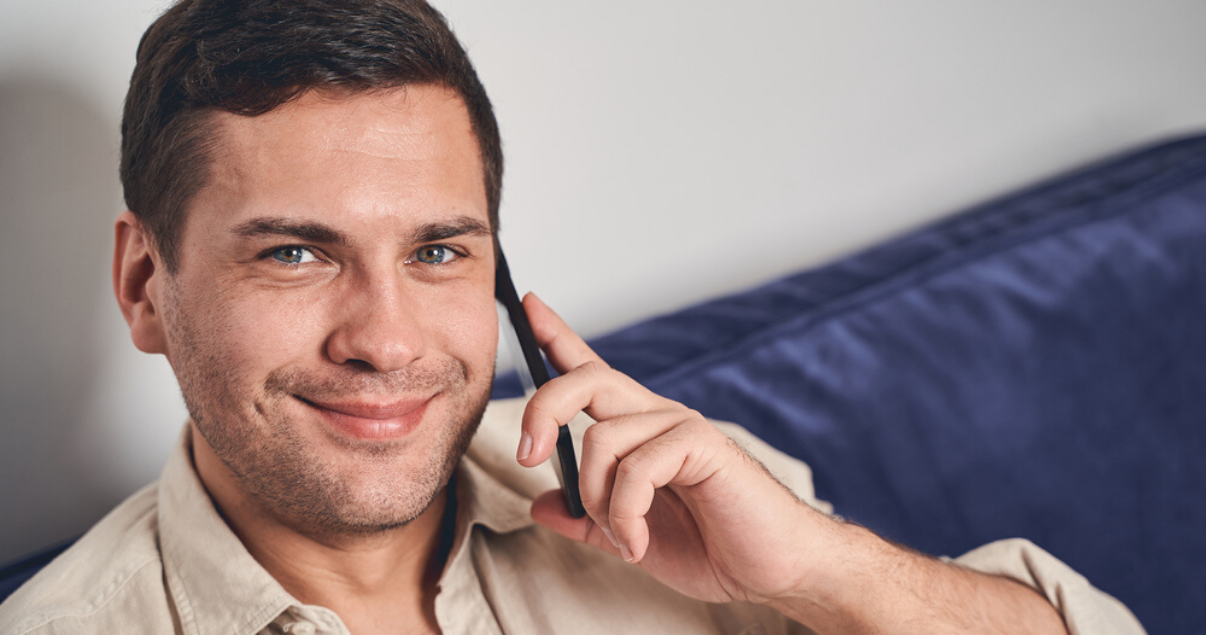 Middle aged man with short hair system for men on phone