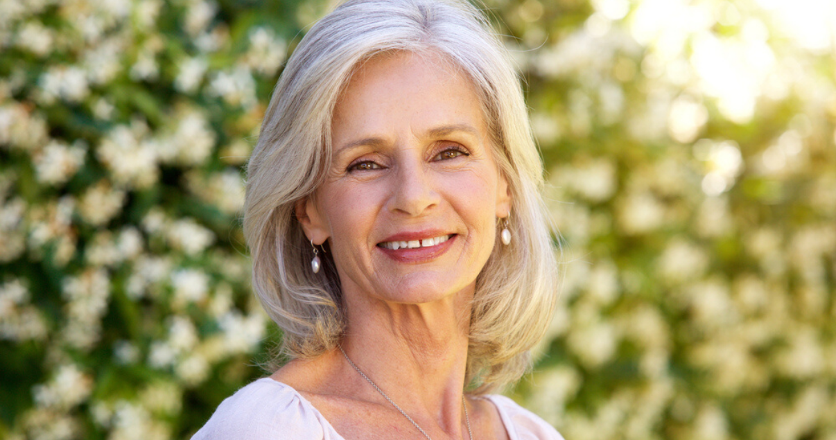 Mature woman with best hair system maintenance