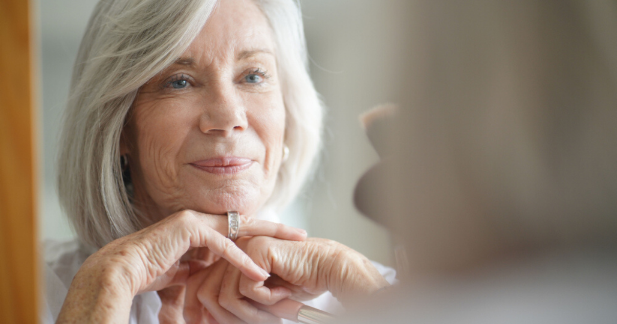 Senior woman looking after hair system lifespan