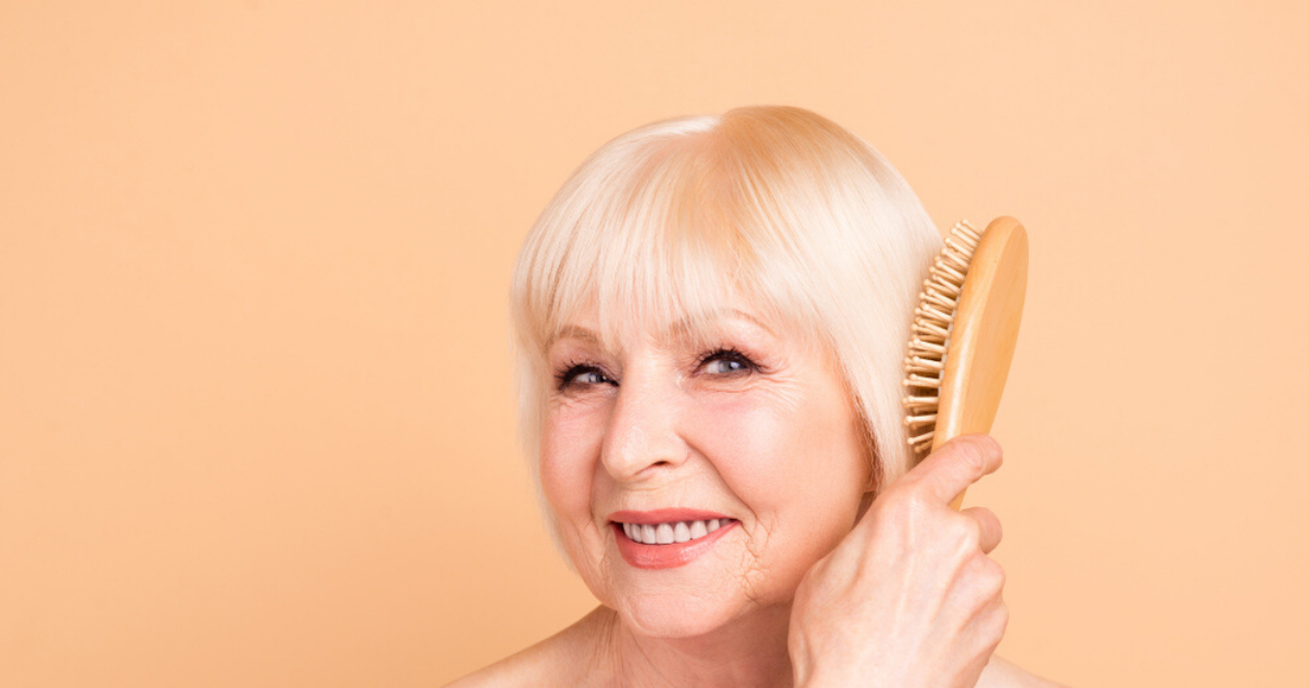 Senior woman with good hairpiece care