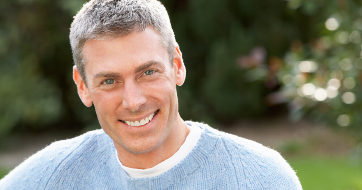Middle aged man with clean hairpiece after following hairpiece maintenance
