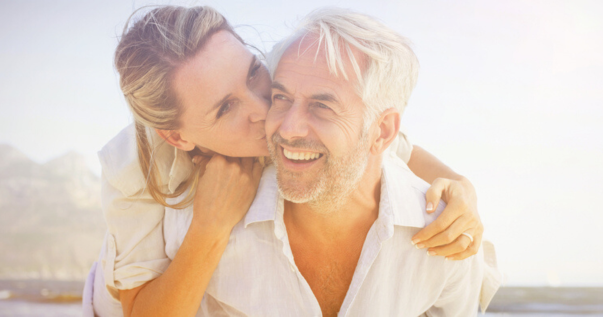 Mature man and woman happy with high quality hair system