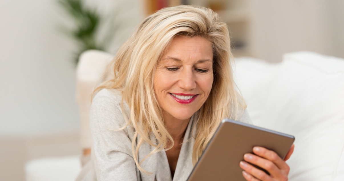 Woman researching hair measurements for hair system