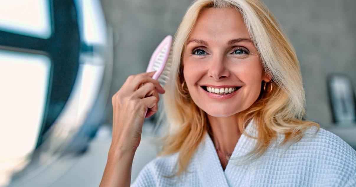 Senior woman increasing her hair system lifespan