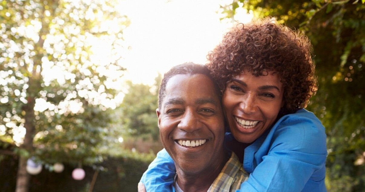 mature couple happy with their hair systems after removing hairpiece adhesive residue