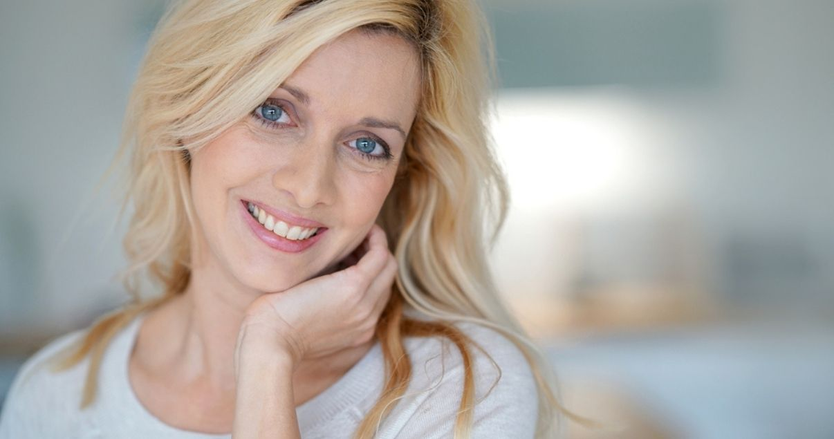 Blonde woman wearing best hair replacement system