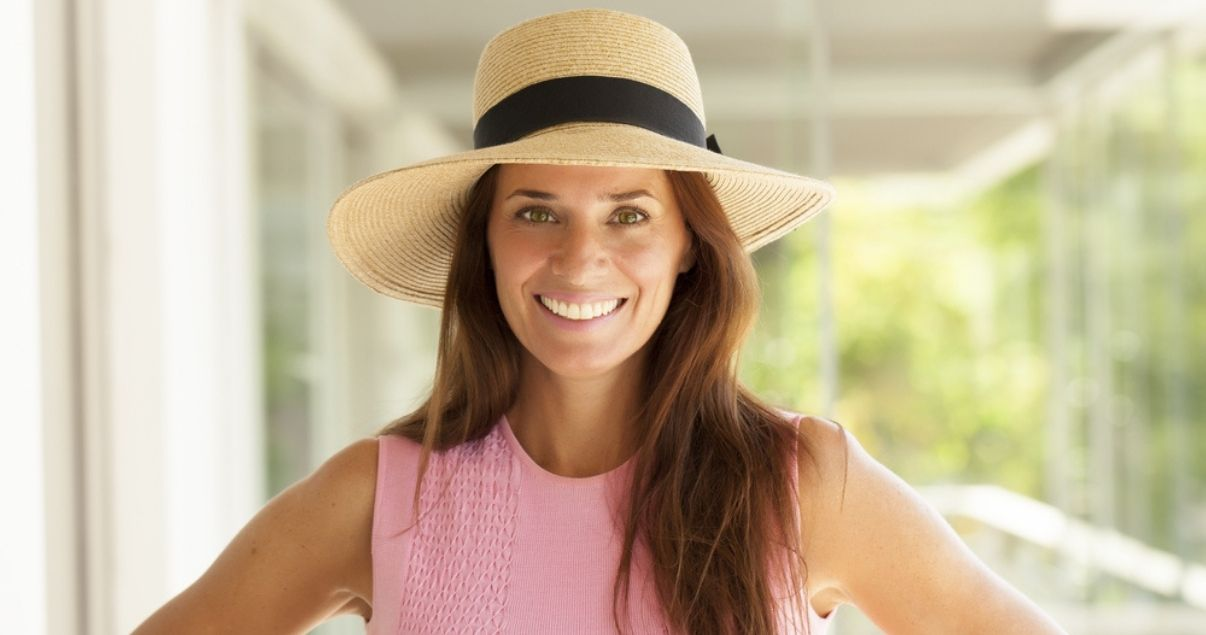 Middle aged brunette woman wearing best hair replacement system