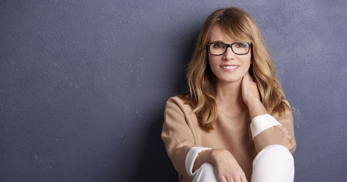 Smiling woman wearing best hair replacement system