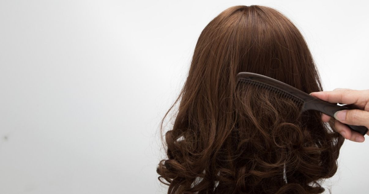 Brunette wig on a stand