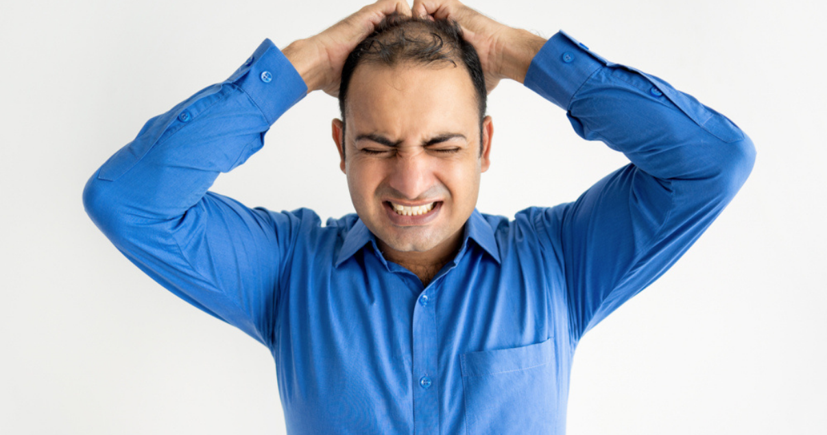 Man with irritation after reciving a hair transplant for men