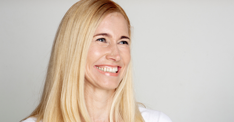 Mature blonde woman wearing human hair wig