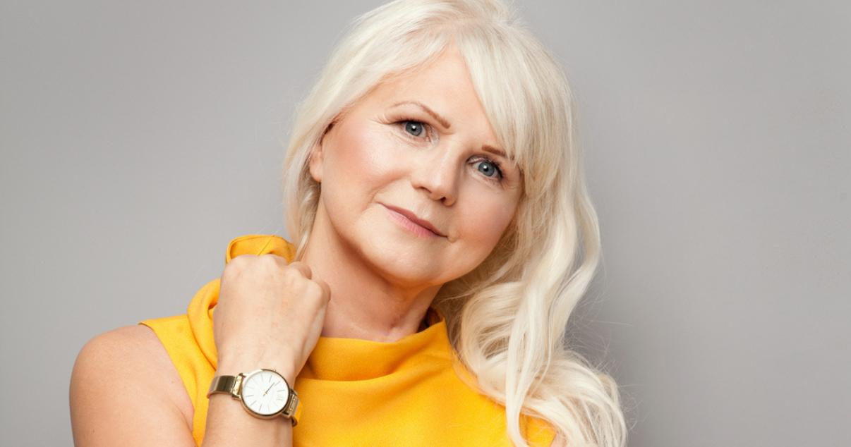 Mature woman wearing natural hair wig