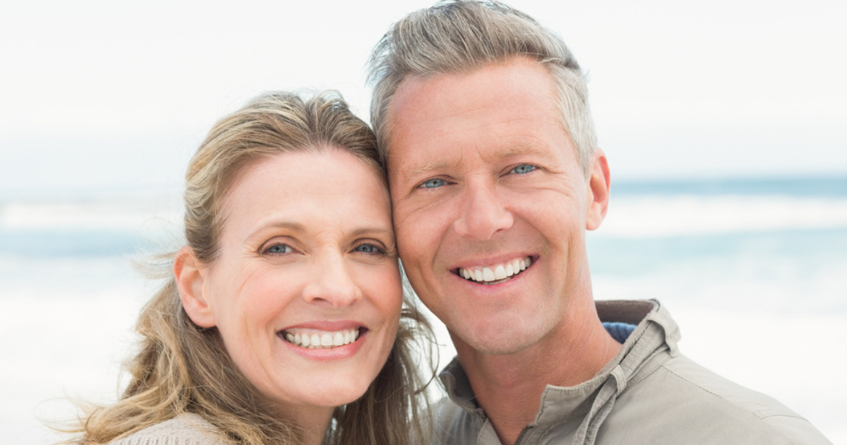 Middle age couple in the beach happy they dont depend anymore on a hair studio (1)