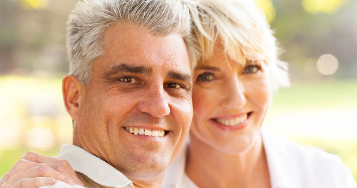 Middle age couple smiling with their hair system