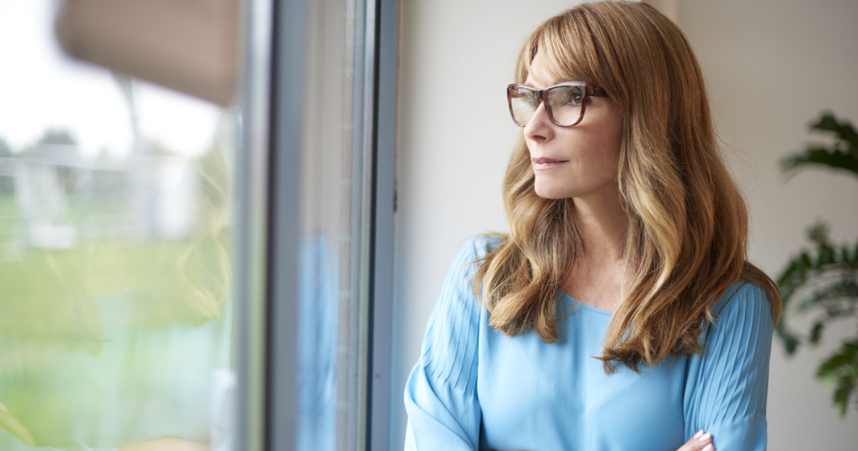 Middle age woman wondering if going outside could cause hair damage from the sun