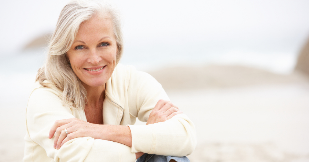 Woman glad that she doesnt have to worry about hair damage from the sun in her hairpiece