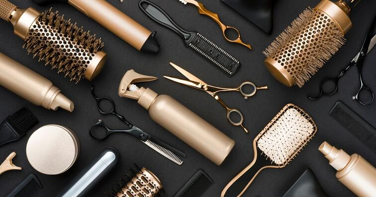 gold hair styling tool on table