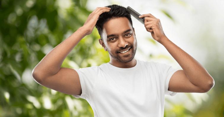 hair_system_maintence_hairbrush_man_brushing_black_hair