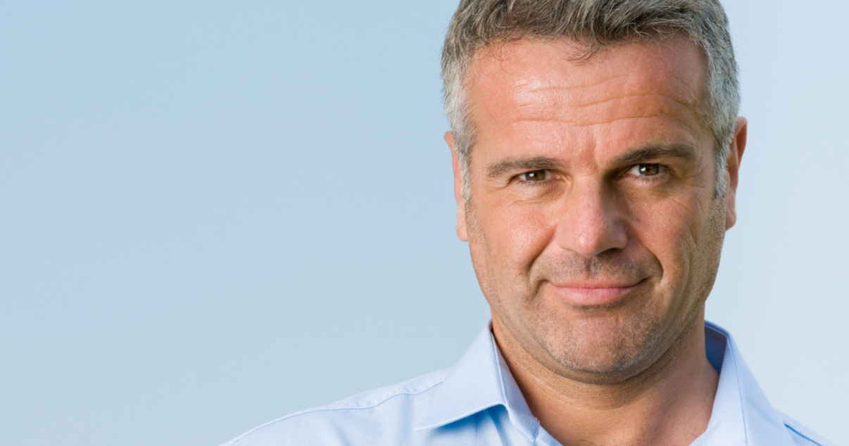 knowledgeable middle aged man who knows what he is looking for in a hair system
