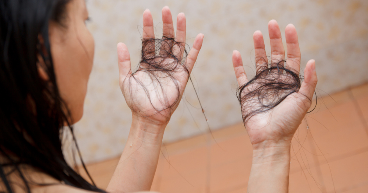 Mature woman with hair falling our of hair system