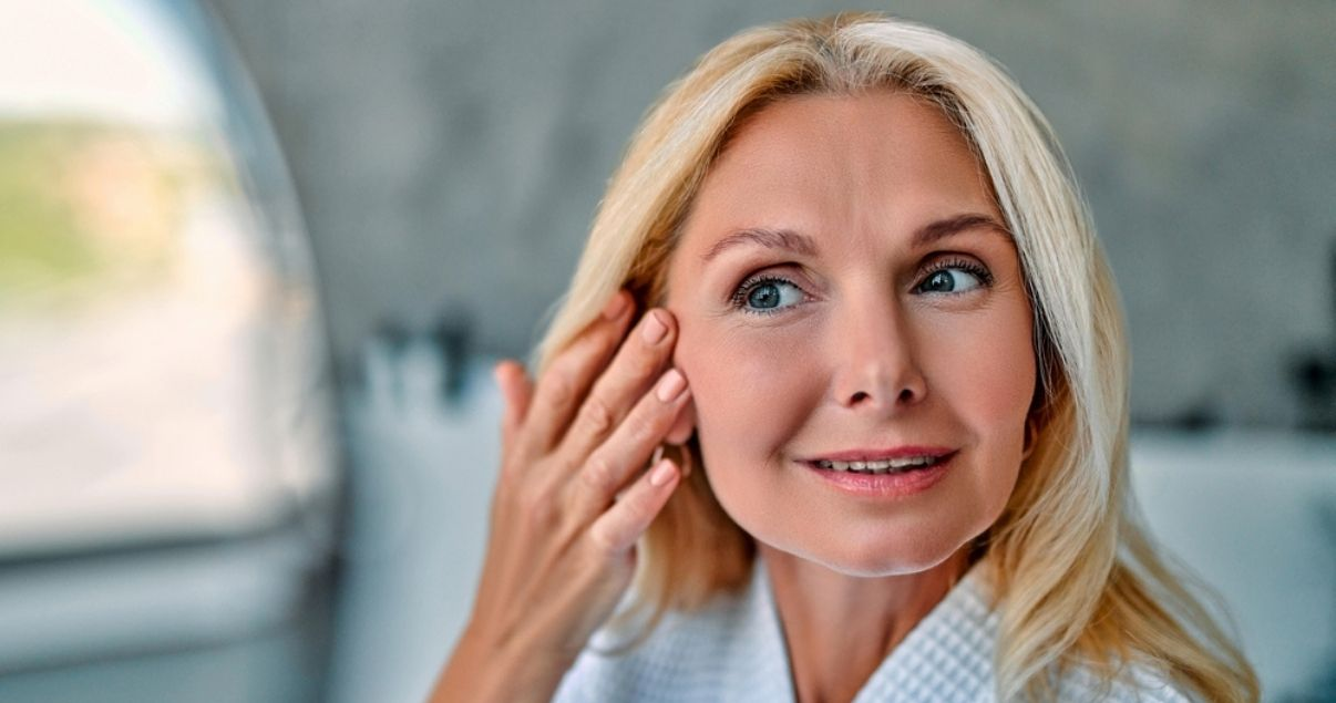Mature blond woman wearing hair system