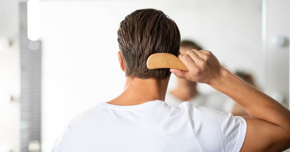Man combing over his hair