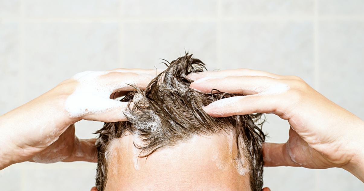 Man taking scalp care