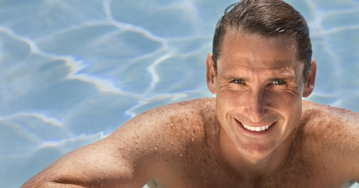 Middle age man excited by the pool because he doesn't have to worry about his hair replacement system getting wet. (1)