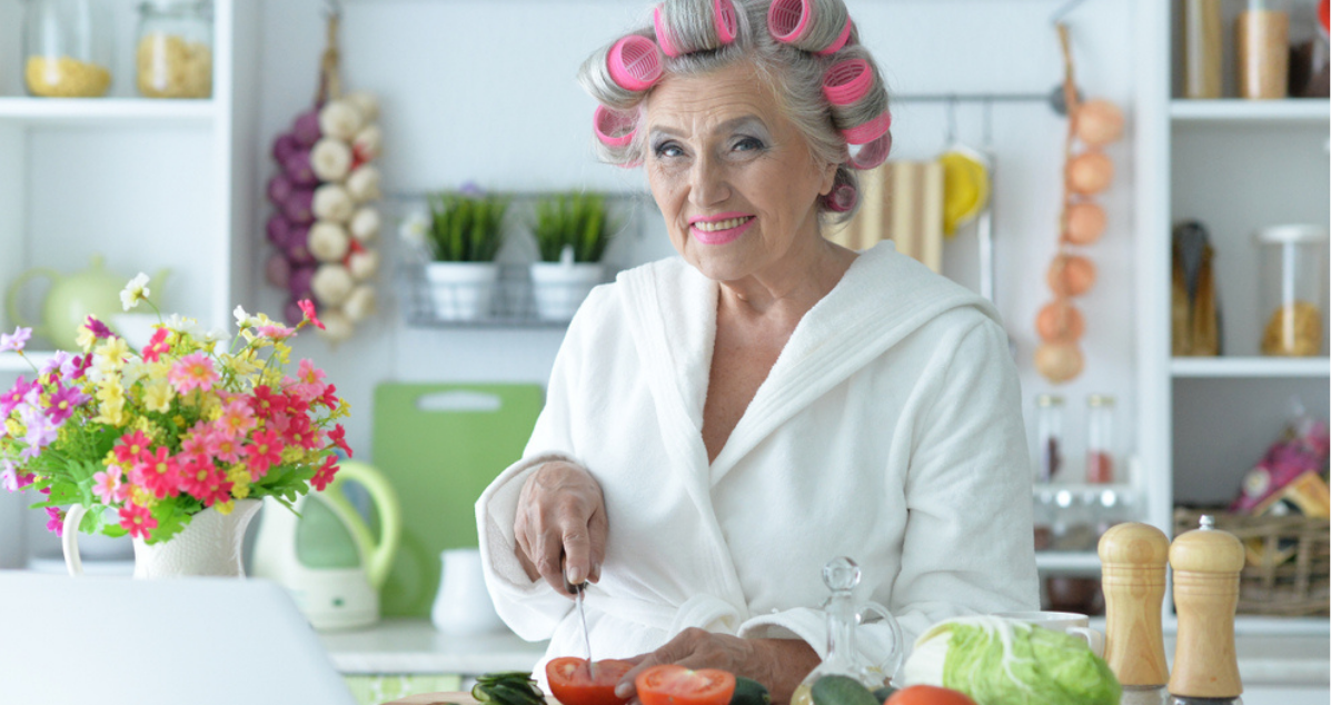 senior woman does hair system care at home