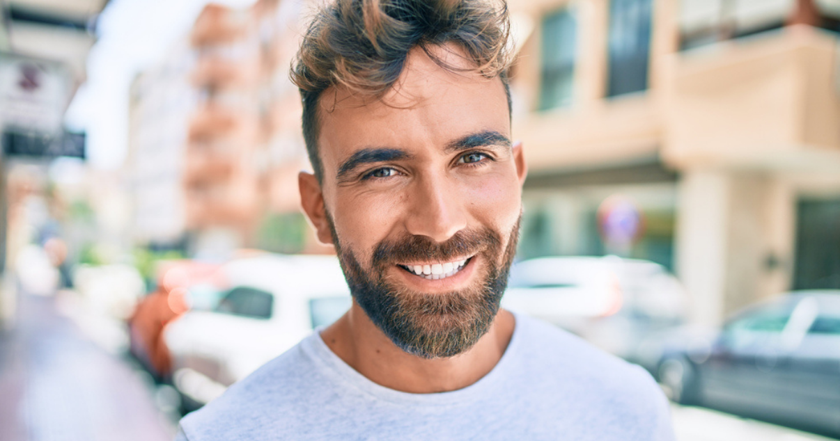 Young man happy that his wig is in great shape